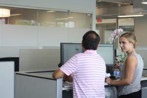 Two UDig employees working