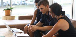 Three UDig employees collaborating