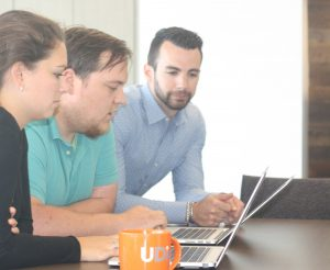 Three UDig employees working