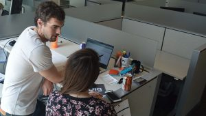 Two UDig employees collaborating