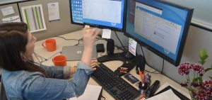 UDig employee at computer
